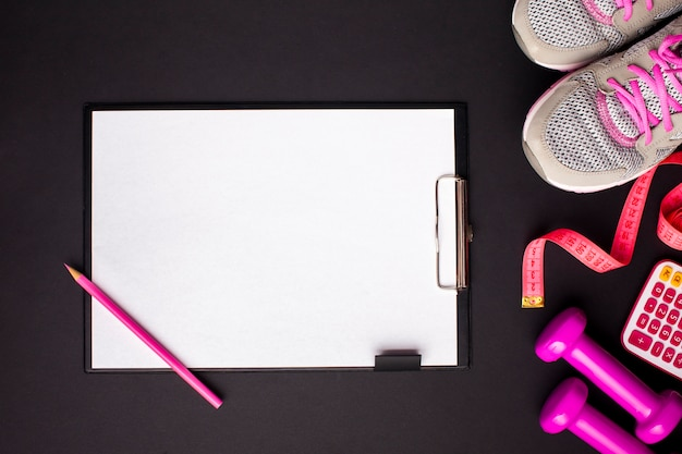 Top view pink sports attributes with clipboard Free Photo