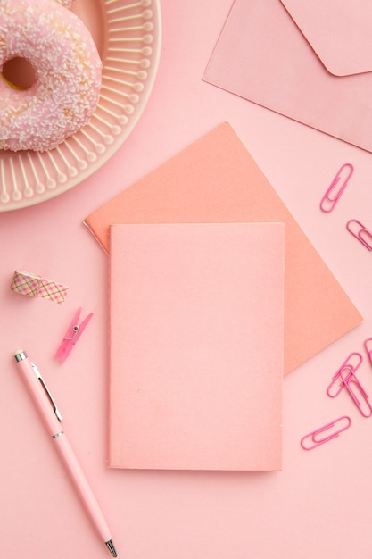Top view pink workplace composition Free Photo