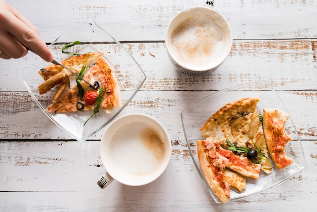 Top view pizza and coffee on white table Free Photo