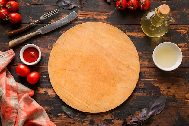 Top view of pizza cutting board on wooden table Premium Photo