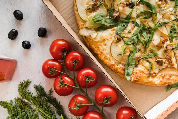 Top view pizza with tomatoes Free Photo