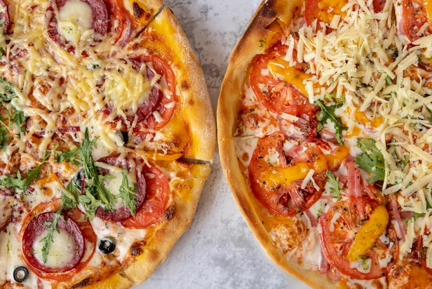 Top view pizzas on cement background Free Photo