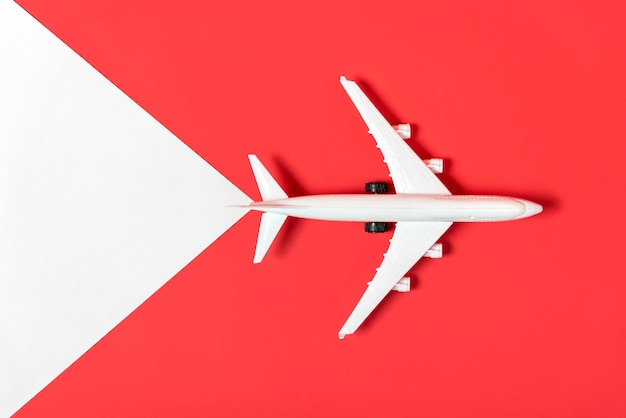 Top view plane on red background Free Photo