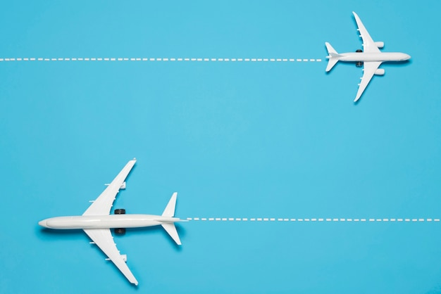 Top view planes on blue background Free Photo