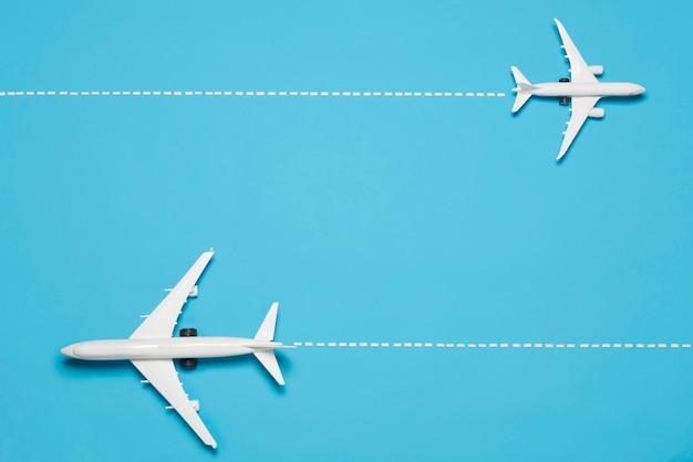 Вид сверху самолеты на синем фоне Premium Фотографии