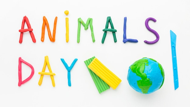 Top view of planet earth and colorful writing for animal day Free Photo