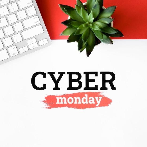 Vista dall'alto della pianta e della tastiera per il cyber lunedì Foto Gratuite