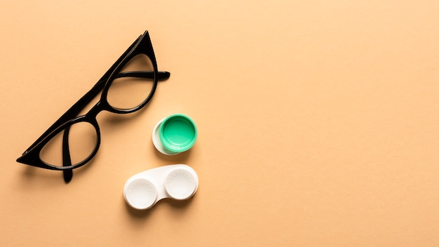 Top view plastic eyeglasses with lenses case Free Photo