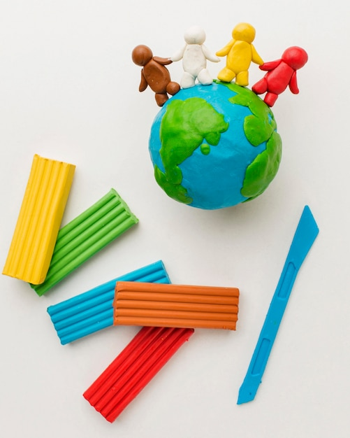 Top view of plasticine earth and people Free Photo