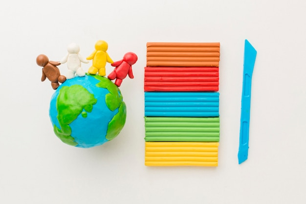 Top view of plasticine people and globe Free Photo