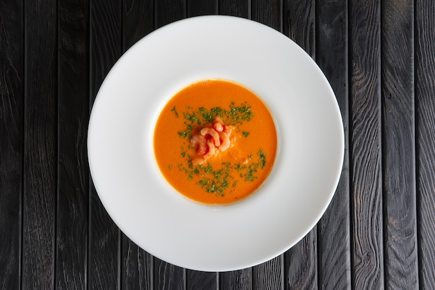 Top view of plate of soup with shrimps Premium Photo