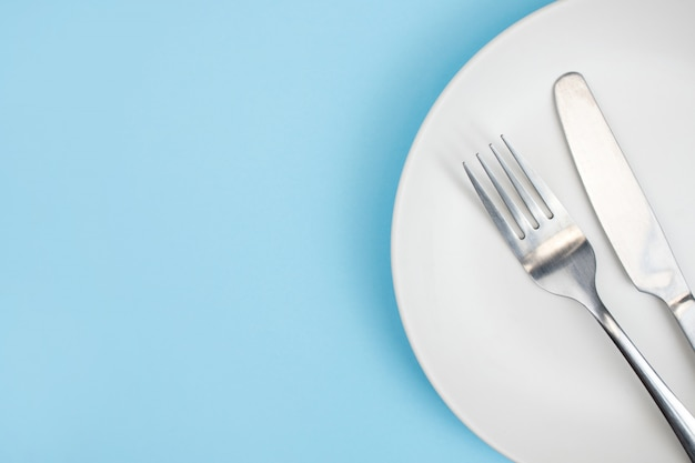 Top view plate with a fork Premium Photo