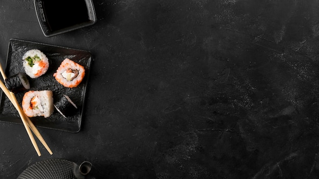 Top view plate with fresh sushi rolls with copy-space Premium Photo