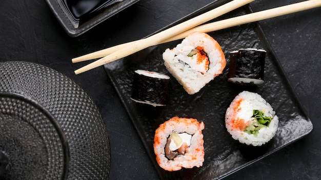 Top view plate with fresh sushi Free Photo