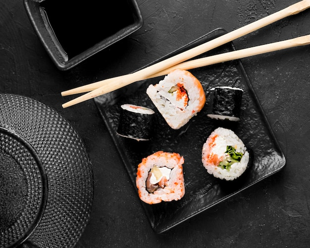 Top view plate with fresh variety of sushi Free Photo