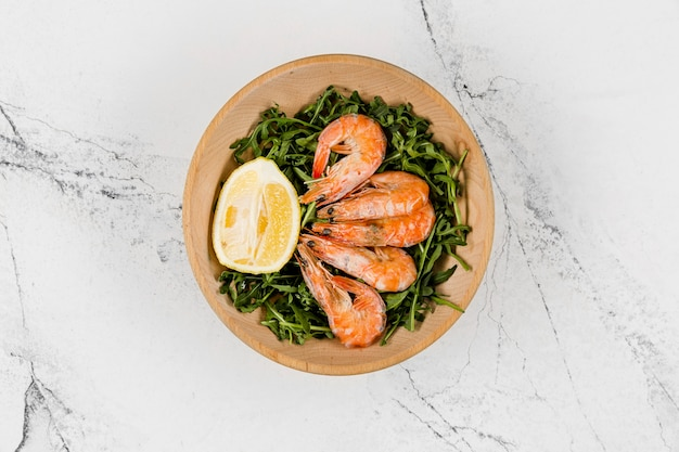 Top view of plate with salad and shrimp Free Photo