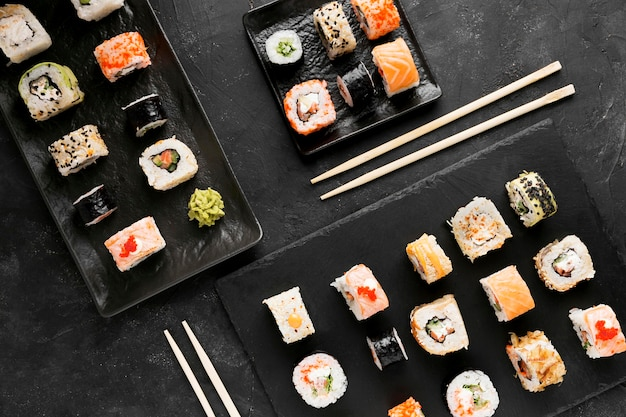 Top view plates with fresh sushi rolls Premium Photo