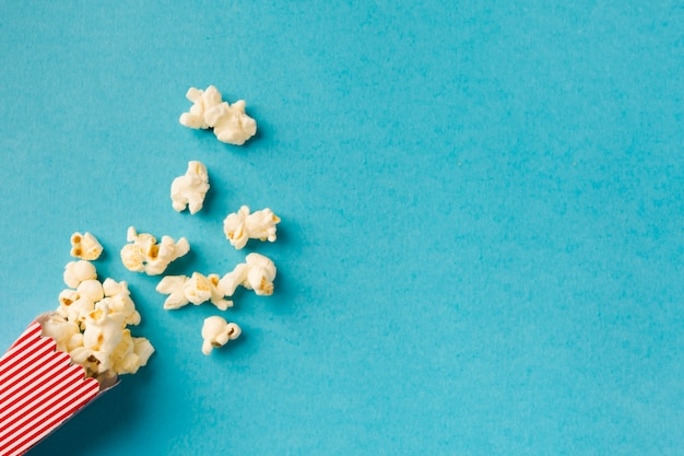 Top view popcorn composition on blue background with copy space Free Photo
