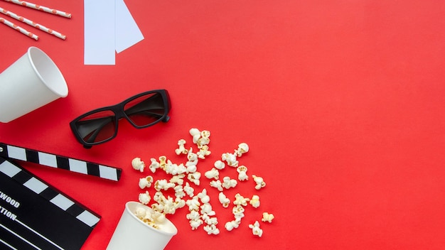 Top view popcorn with cinema clapperboard on the table Premium Photo