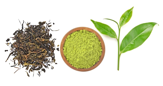 Top view of powder green tea and green tea leaf isolated on white background Premium Photo