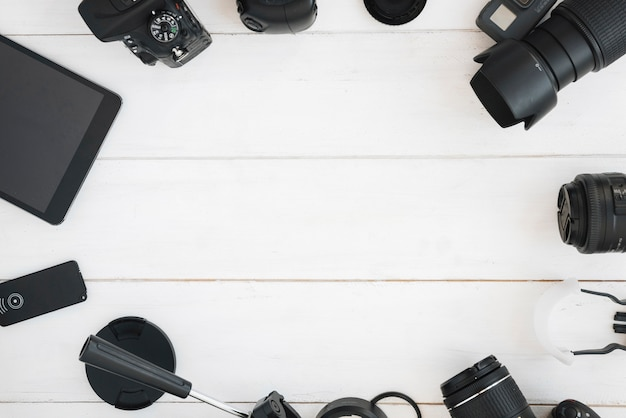 Top view of professional photography accessories on white wooden table Free Photo