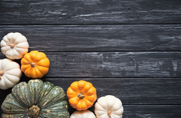 Top view of pumpkin on old wooden background. thanksgiving day concept. Premium Photo