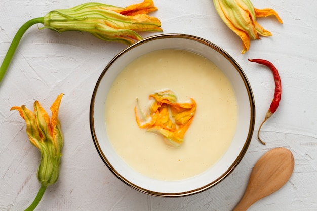 Top view pumpkin soup with dried flowers Free Photo
