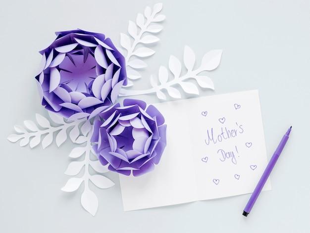 Top view purple paper flowers arrangement Free Photo
