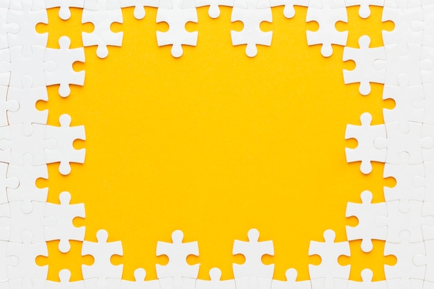 Top view of  puzzle frame concept Free Photo