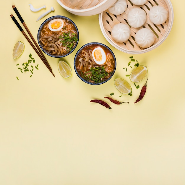 Top view of ramen bowls and dim sum Free Photo