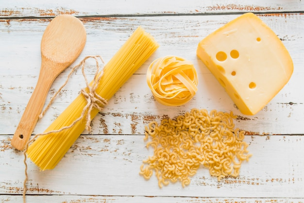 Top view raw pasta with cheese Free Photo
