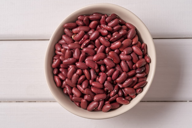 Top view red beans in a bowl over white wood Premium Photo