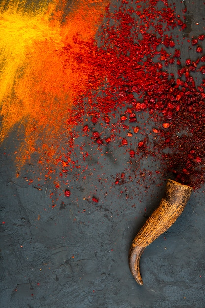 Top view of red chilli and sumac powder spices with curry on black Free Photo