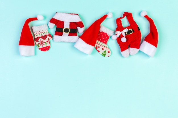 Top view red santa hats. time for holiday concept with empty space for your design Premium Photo
