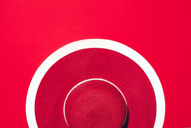 Top view of red striped retro hat over paper background with copy space. s Premium Photo