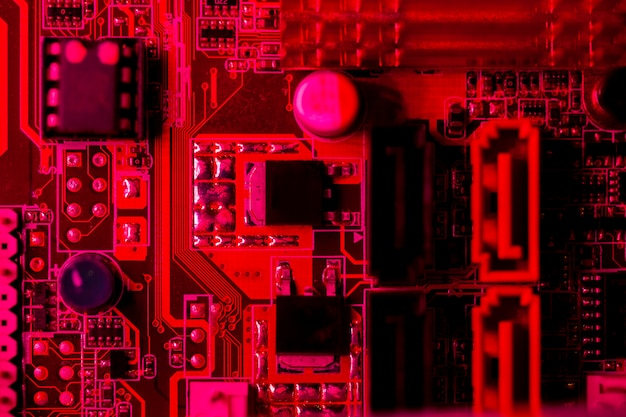 Top view red themed circuit board Photo | Free Download
