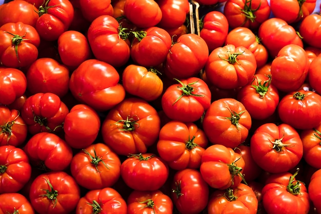 Top view red tomatoes pile Free Photo