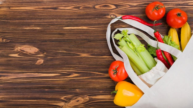 Top view of reusable bag with fruit and vegetables Free Photo