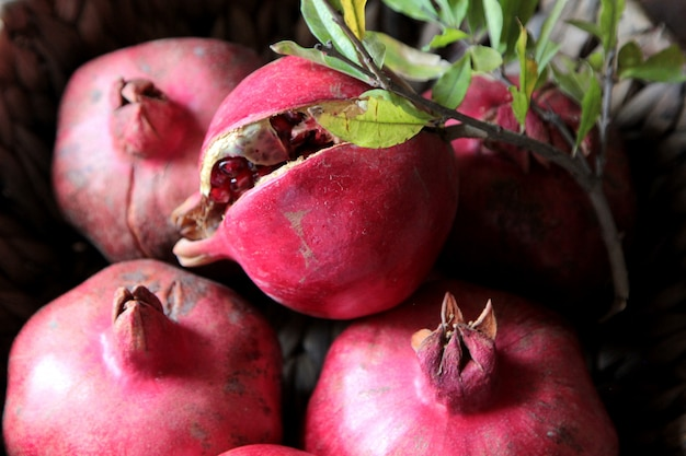 Top view ripe pomegranates with a branch from a tree Free Photo