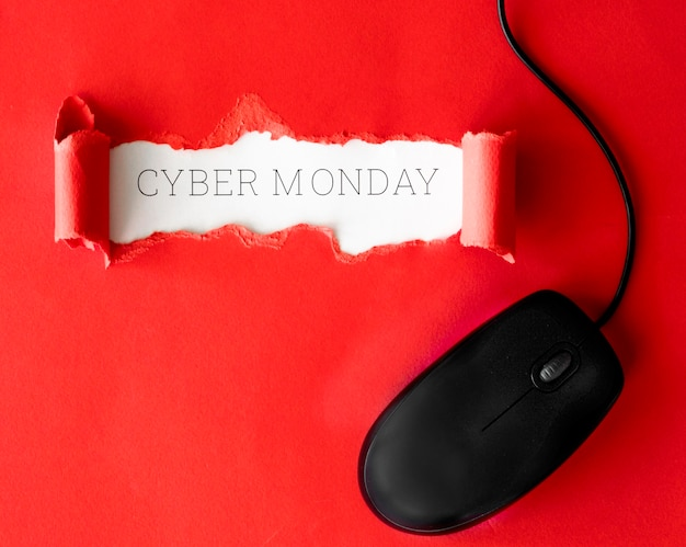 Free Photo Top View Of Ripped Paper With Mouse For Cyber Monday