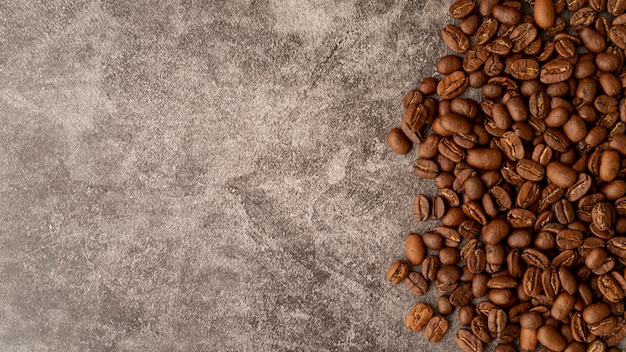 Top view roasted coffee beans with copy space Free Photo