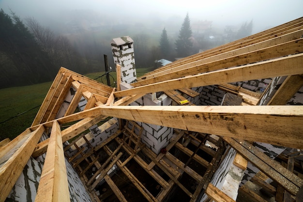 Top view of roof frame from wooden lumber beams Premium Photo