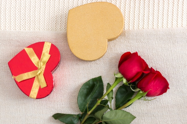 Free Photo Top View Roses And Heart Shaped Box Of Candies In Bed