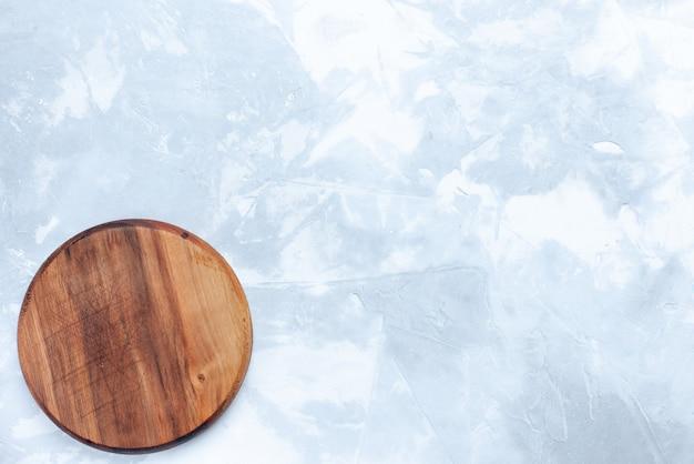 Vista dall'alto rotondo scrivania marrone in legno sullo sfondo chiaro legno di colore chiaro cibo Foto Gratuite