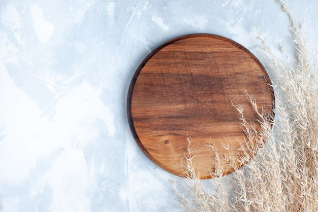 Top view round wooden desk on the light background wood wooden light color photo Free Photo