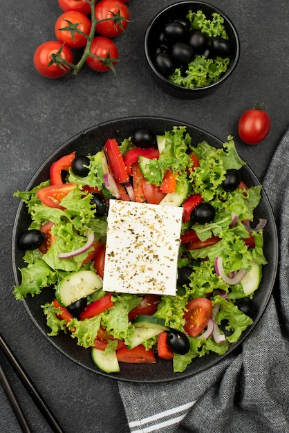 Top view salad with feta cheese, tomatoes and olives Free Photo