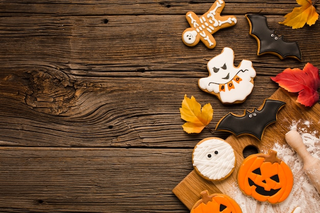 Top view scary halloween cookies on wooden background ...