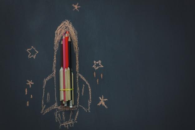 top view school elements on chalk board Free Photo