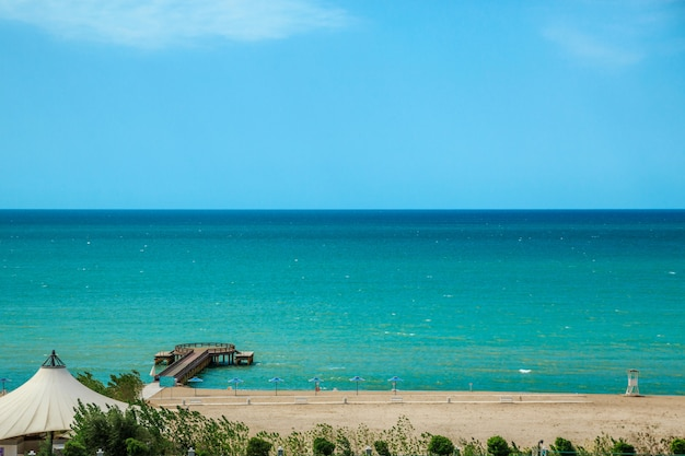 Top view of the sea and sandy beach with beautiful sky with clouds Premium Photo