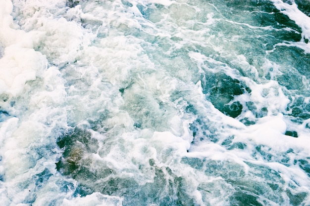 Top view of the sea waves and foam in a storm Premium Photo